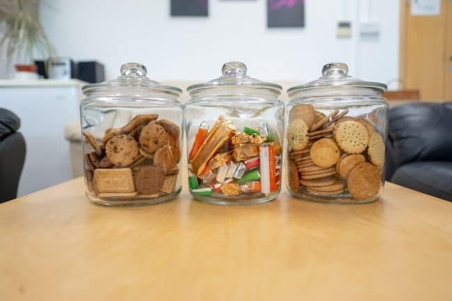 picture of our sitting room with cookies and chocolate in glass jars